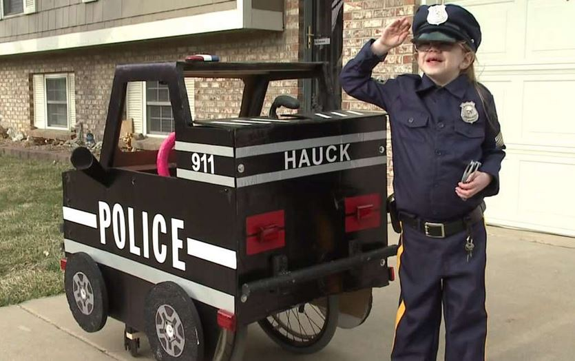 Dad converts daughter's wheelchair into mini police car to ensure she's happier in it