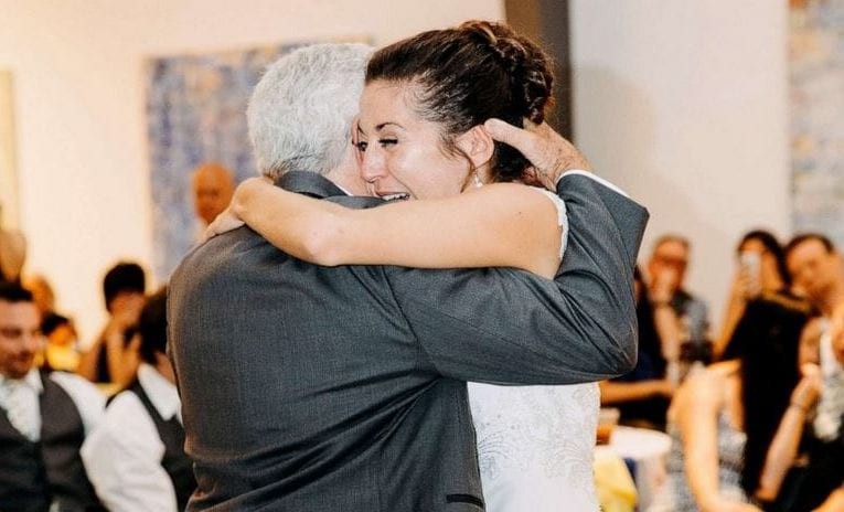 Dad overcomes paralysis to surprise his daughter with 1st dance on her wedding day