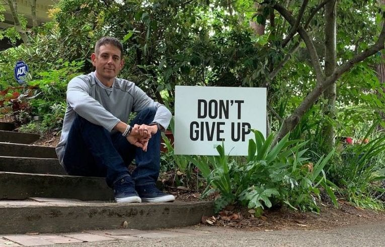 Motivated Dad posts 'Don't Give Up' signs around town to lower community suicide rates