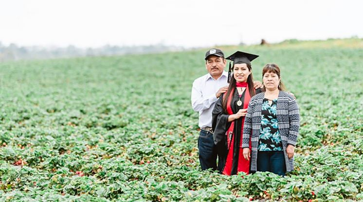 Student honors immigrant parents with graduation photos in the fruit fields where they worked