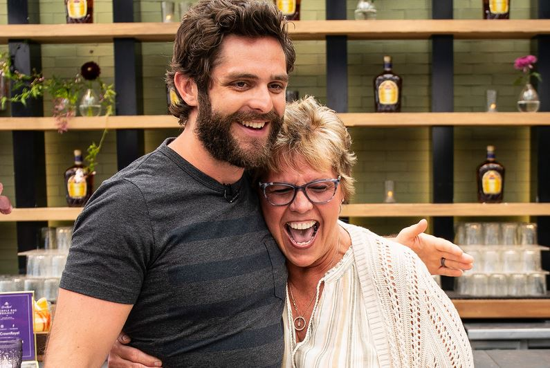 Country Star, Thomas Rhett, Surprises Women with Their Military Children for Mother's Day