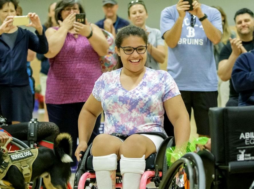 Olivia Curcuru presented with custom wheelchair at Angel City Games, 2019.