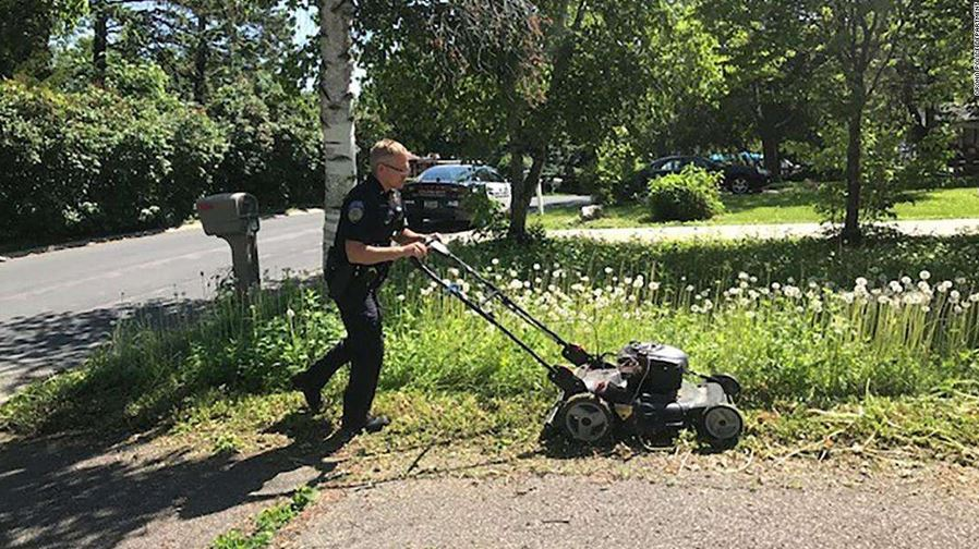 © Orono Police Department Orono Police Officer Matt Siltala mows a resident's lawn.