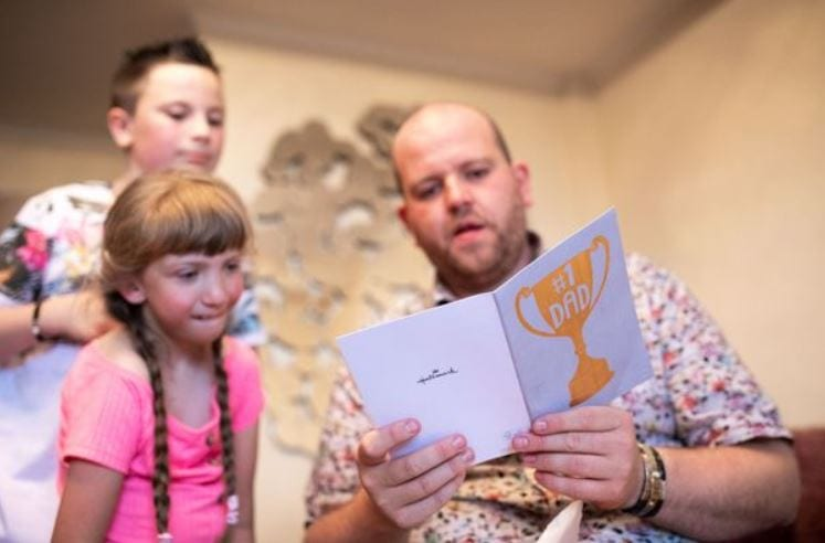Ben receiving his fathers day card from his kids (Image: Caters News Agency)