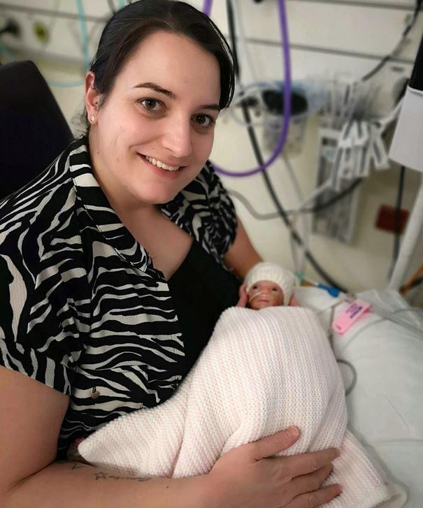 Mom, Laura Worsley holds new born rainbow baby, Ivy.