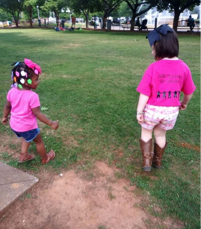 Tynslee Blue, 5, and a friend help distribute care packages to the homeless in a local park.
