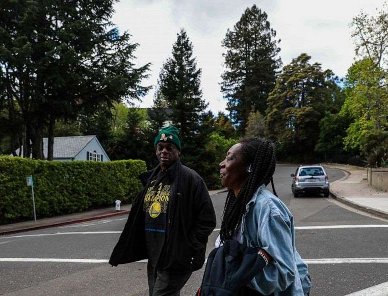 © Yalonda M. James/San Francisco Chronicle via Polaris Greg Dunston, Sr. and his partner Marie Mckinzie walk back home after visiting Hampton Park, in Piedmont, Calif., on April 16, 2019.