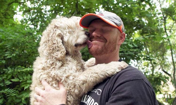 Mason Taylor with Mack the dog at Old Friends Senior Dog Sanctuary in Tennessee.