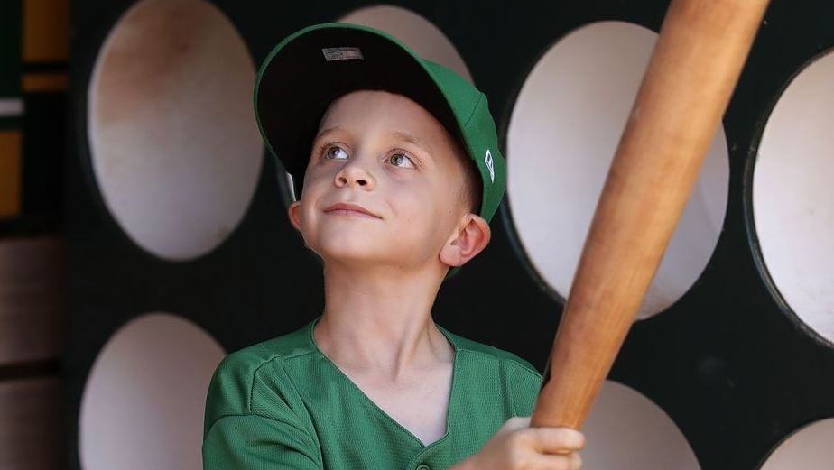 Little baseball fan lives his dream of signing with the Oakland A's for a game via Make-A-Wish. Source: Oakland Athetics/Oakland A's