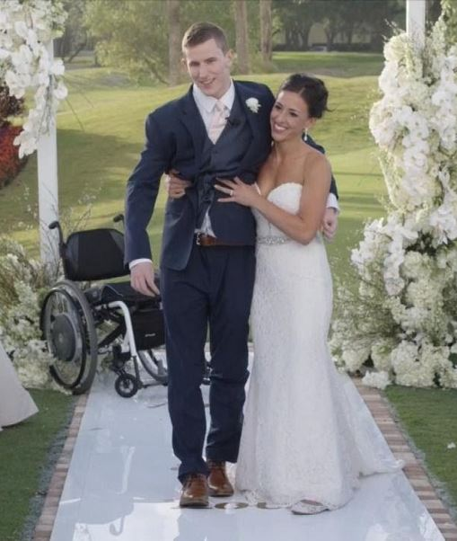 Chris Norton walks down the aisle with wife Emily.