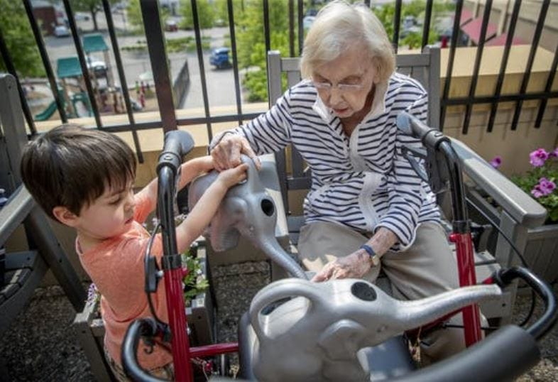 "Logan Clifford lent a hand to Evelyn Thoreson. The children look forward to seeing their ""grandfriends."""