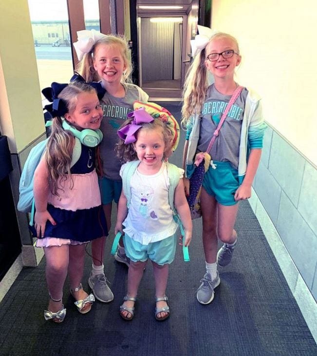 Sisters Evelyn, 4, Mary Anson, 11, Eleanor, 7 and Susanna Tate, 11, are raising money in hopes to help pay for the adoption of their fifth sibling.
