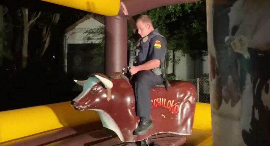 Texas police officer responded to a noise complaint at a house party and ended up riding a mechanical bull.