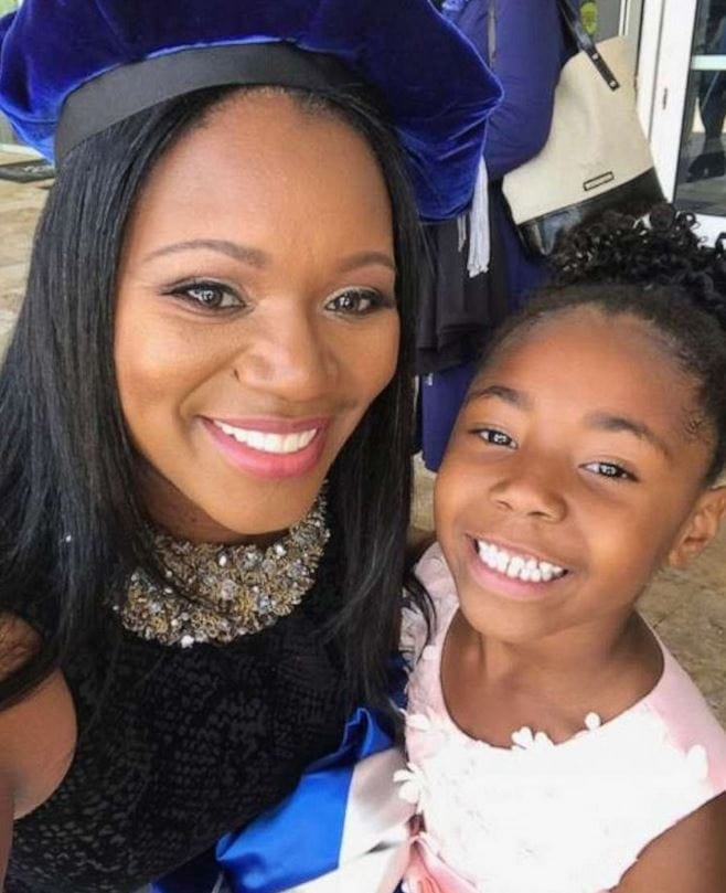 Yolanda Perkins poses with her daughter, Bella, 6, during her graduation in Florida.
