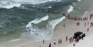 Human chain forms to rescue couple from rip current in Florida panhandle. Source: Brian Daniels/James Spann - Twitter