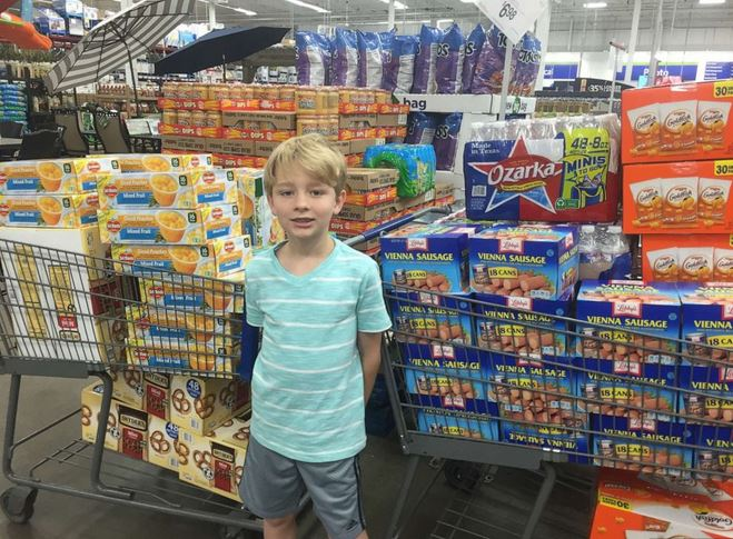 Matthew Reel, 12, helps pack food for those in need in his hometown. Credit: Tammy Reel -- Source: GMA
