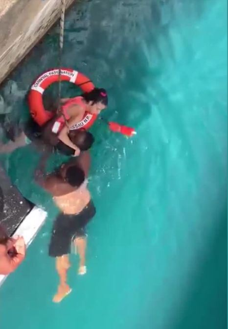 Two heroes are being praised for jumping in to save woman in wheelchair who fell off cruise ship dock. Credit: Randolph Donovan