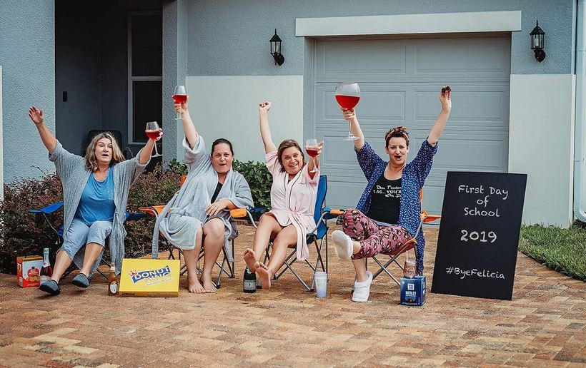 A group of Florida moms hilariously celebrate the first day of school with wine and donuts. Credit: Shawna Genua / Wee Winks Photography/Shawna Genua / Facebook