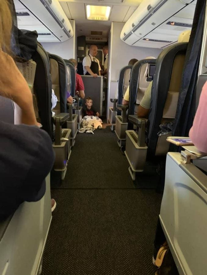 Passengers and crew of United flight help mother calm autistic boy having a meltdown before takeoff. Credit: Lori Gabriel