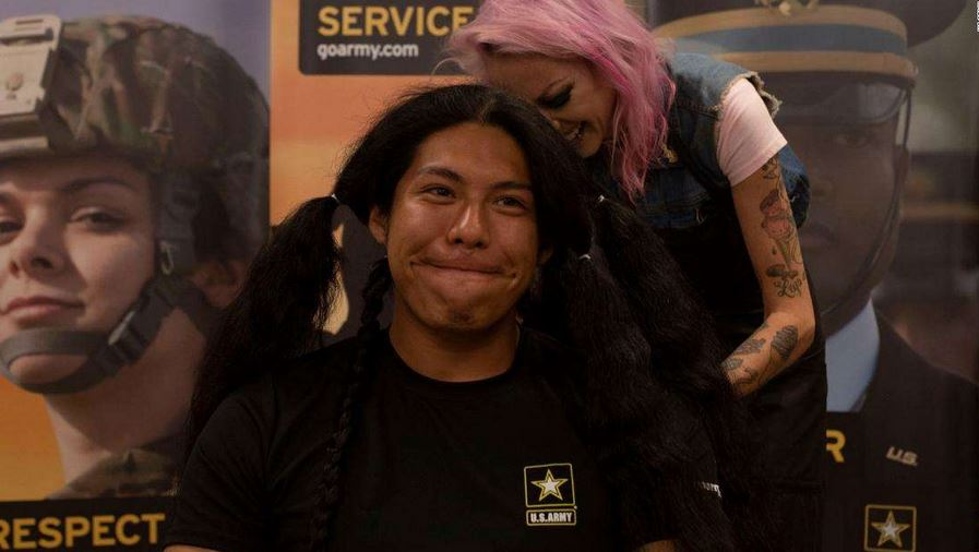 Reynaldo Arroyo, 23, recently got a haircut for the first time in 15 when he recently enlisted with the U.S. Army.  Credit: US Army
