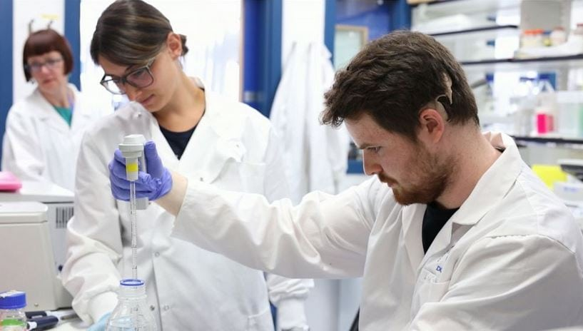 Liam McMulkin is here working in the lab.  He created more than 100 new signs for scientific terms to help himself and future students. Credit: University of Dundee - Source: abc