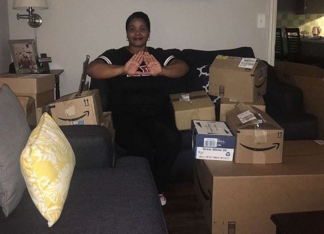 Michelle Lindsey poses with school supplies donated by members of Delta Sigma Theta Sorority.