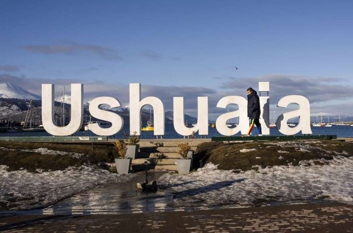 Aranda walks past a sculpture of the name of the world's southernmost city, as he arrives in Ushuaia, Argentina.