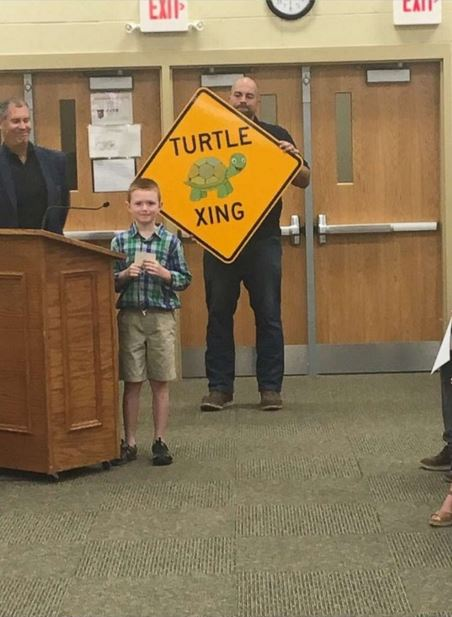 Little boy gets turtle crossing signs installed after adorable letter to the city mayor expressing his concern.
