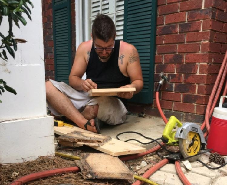 Jon Potter, 29, fixing rotted porch posts in Pittsburgh for someone for free