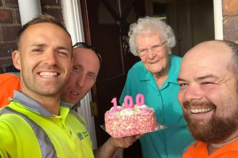 Garbage men surprise elderly woman on her 100th birthday with a cake and a little happiness.