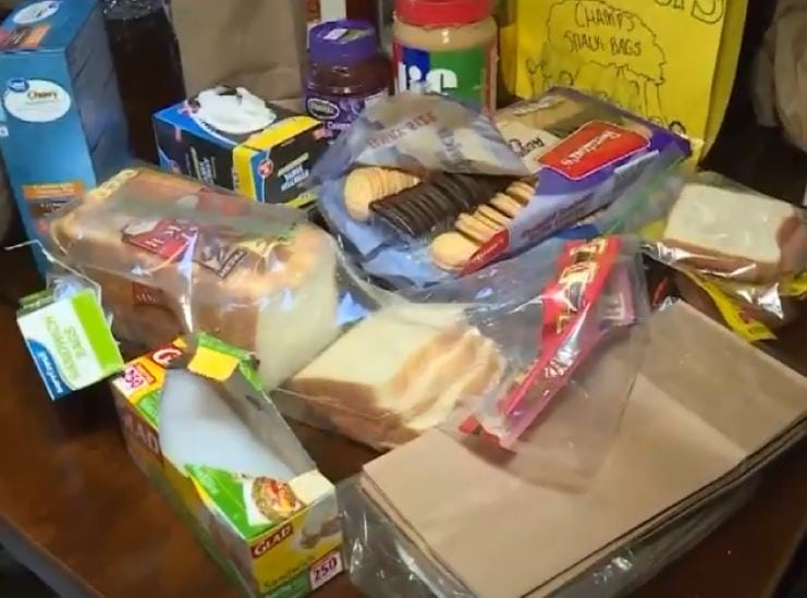 For 5 years, this caring mother of 6 has been giving out over 100 lunches a day to kids living in poverty. Credit: Champale Greene-Anderson