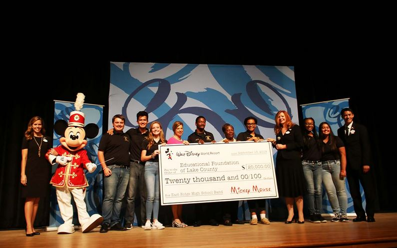 Disney shares the magic by donating $20k to support band students who were devastated by school fire.