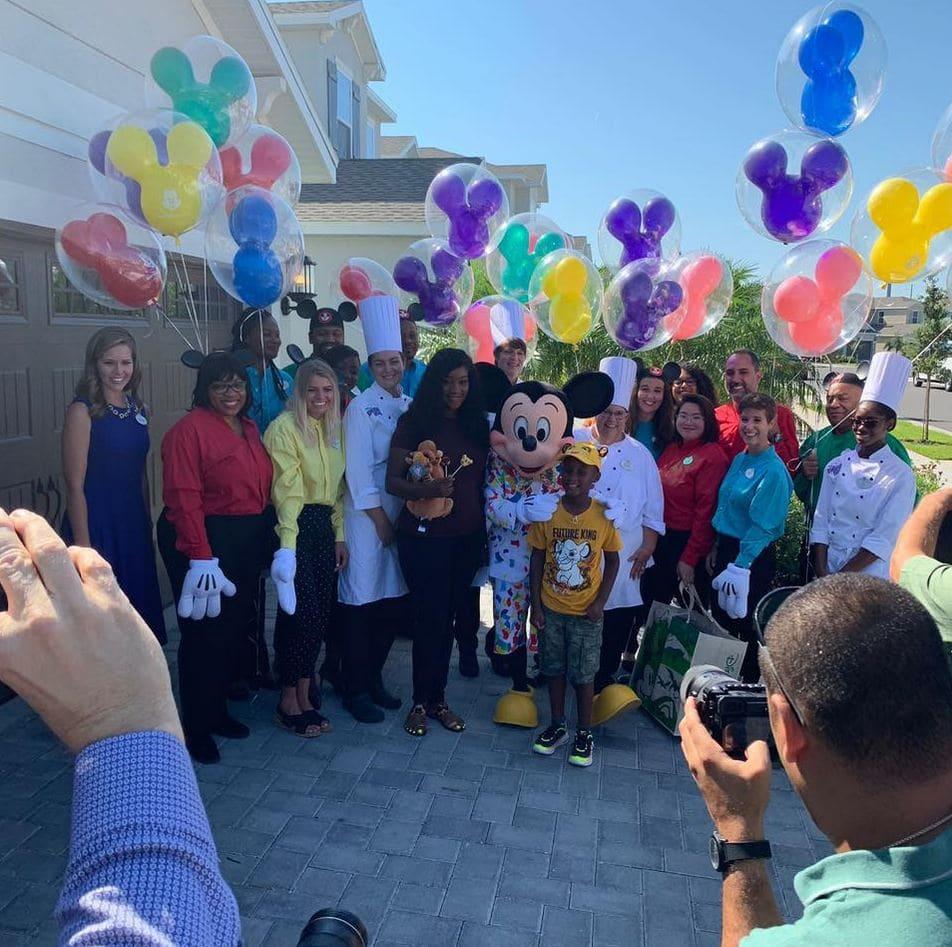 Boy who used his Disney trip money to feed Hurricane Dorian evacuees got surprised with dream Disney vacation. Credit: Lauren Creech/Disney Parks