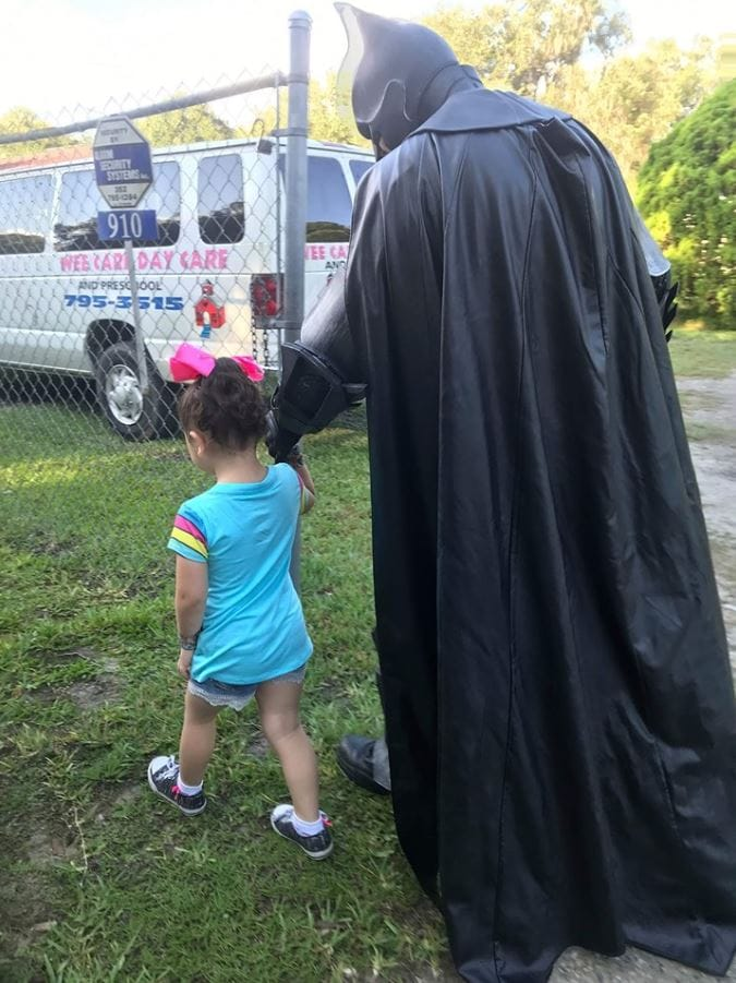 Batman walks little girl to Day Care to boost her confidence after hearing she was being bullied.