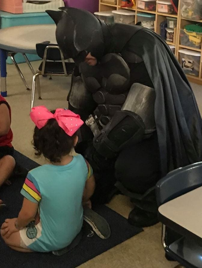 Batman walks little girl to Day Care to boost her confidence after hearing she was being bullied. Credit: Batman of Spring Hill - Facebook