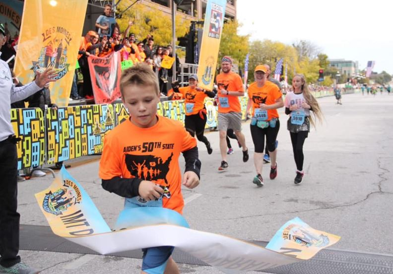 11-year-old boy breaks world record of being the youngest person to run a half marathon in all 50 states