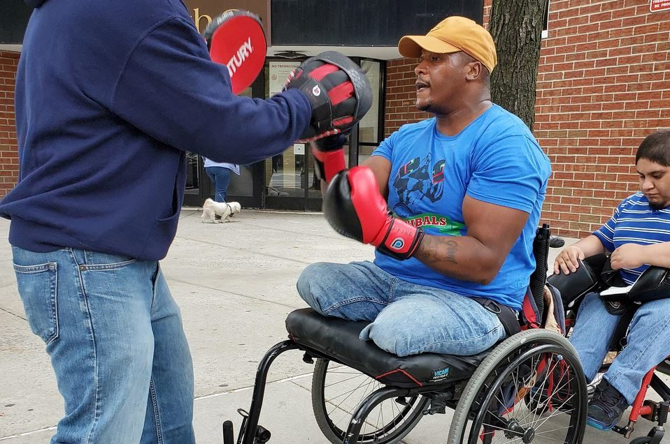 Double amputee overcomes severe depression by learning to box - now he's helping others with disabilities.