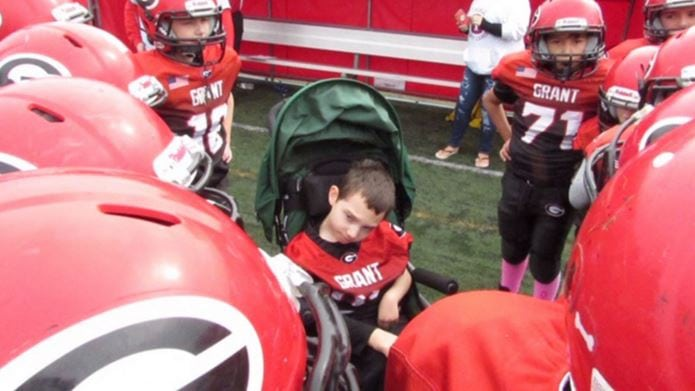 A compassionate high school football team makes 7-year-old with cerebral palsy team captain for the day