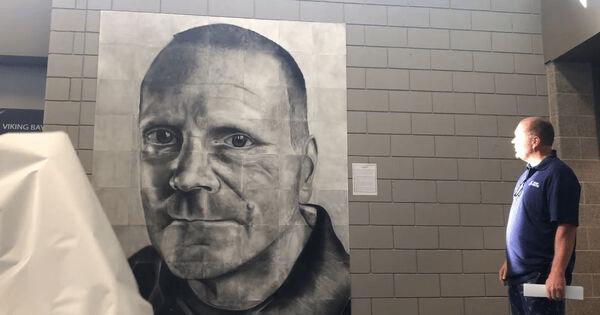 'The Unsung Hero' - High school students honor beloved custodian with massive hand-drawn portrait. Credit: Seaman High School