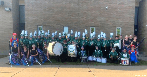 Genius Idea – A high school football team with no band invites band with no football team to play at its games