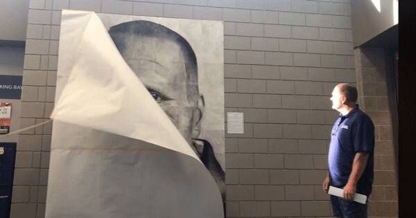 'The Unsung Hero' - High school students honor beloved custodian with massive hand-drawn portrait.