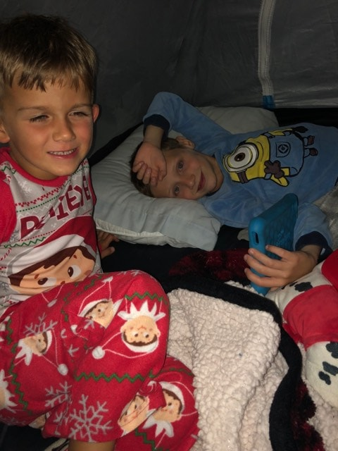 Michael (left) and his friend Jaxson (right) camping out in a tent together.