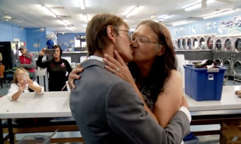 Homeless couple of 11 years gets married at laundromat in sweet ceremony.