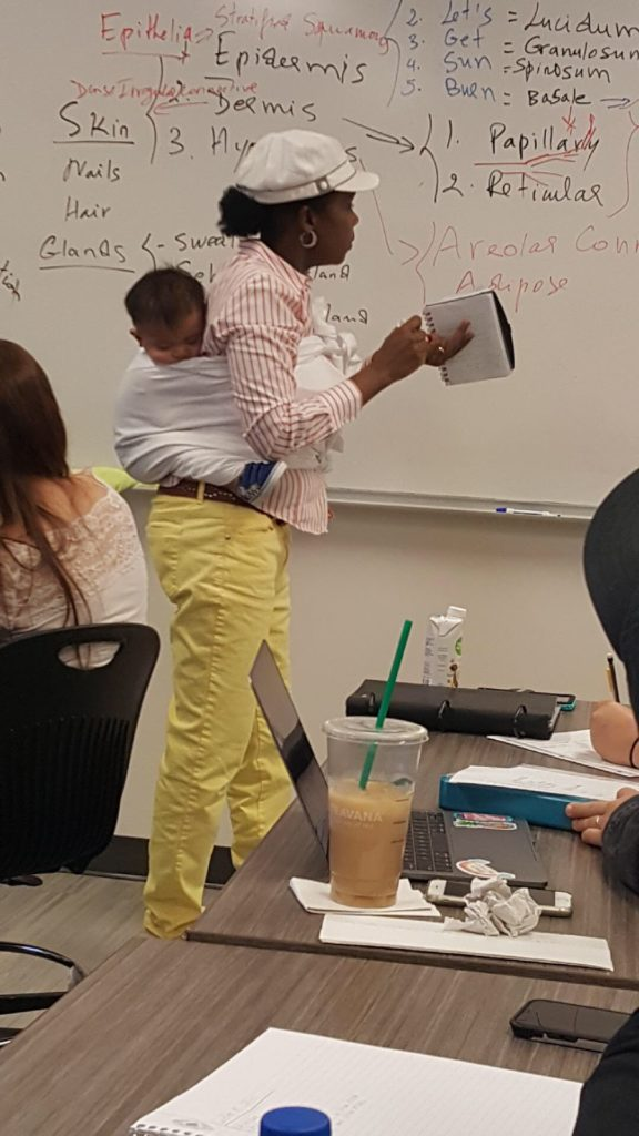 Professor holds her student's baby during a 3-hour lecture so the mom can focus and take notes.