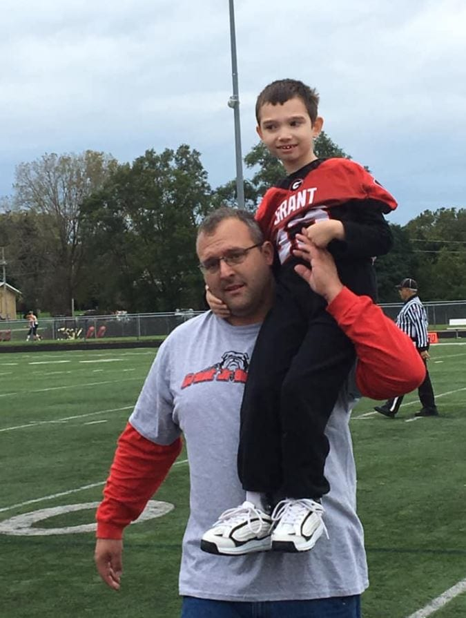 A compassionate high school football team makes 7-year-old with cerebral palsy team captain for the day. Credit: Brittany Jenkins