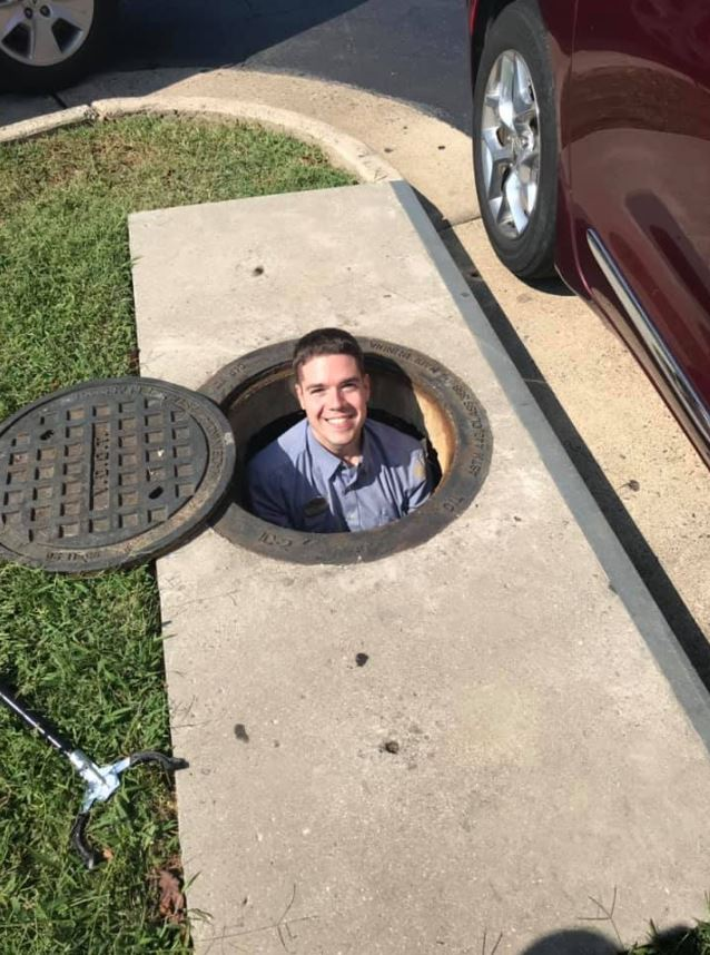 Daring Chick-fil-A employee jumps into a storm drain to rescue a customer's iphone.