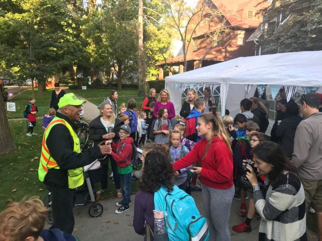 80-year-old crossing guard gets surprised by community kids on his birthday