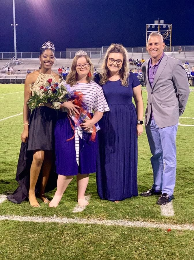 Teen with epilepsy couldn't wear heels during homecoming, so everyone went barefoot to support her. Credit: Crystal Lotz Hadden