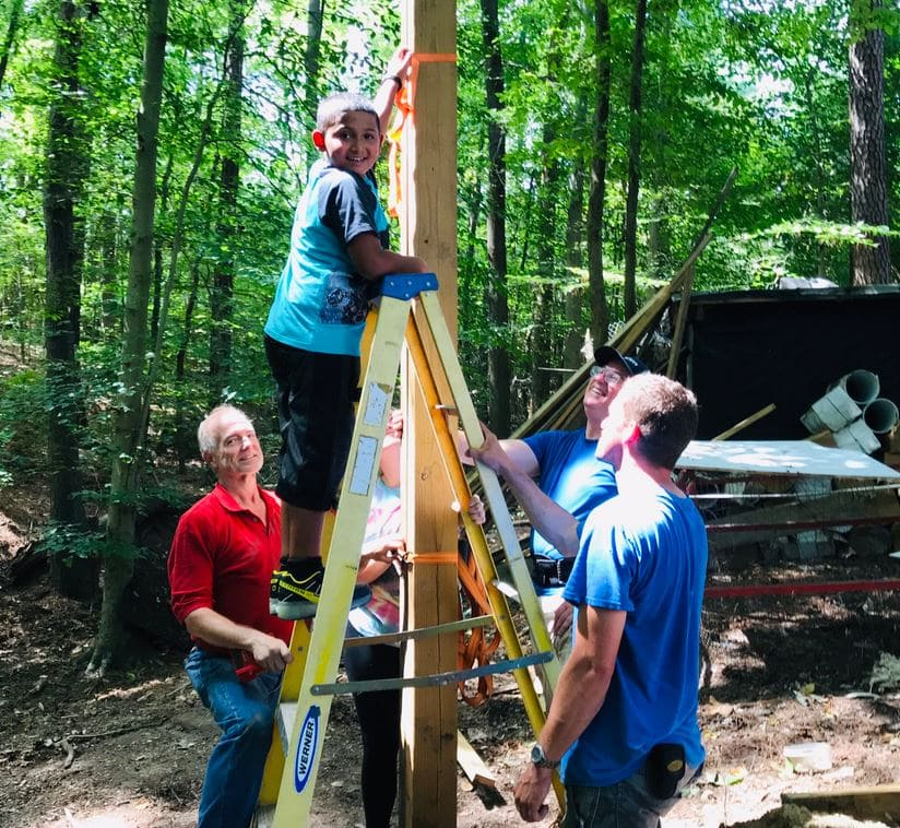 Volunteers from across 2 states come together to build a dream treehouse for terminally ill little boy.