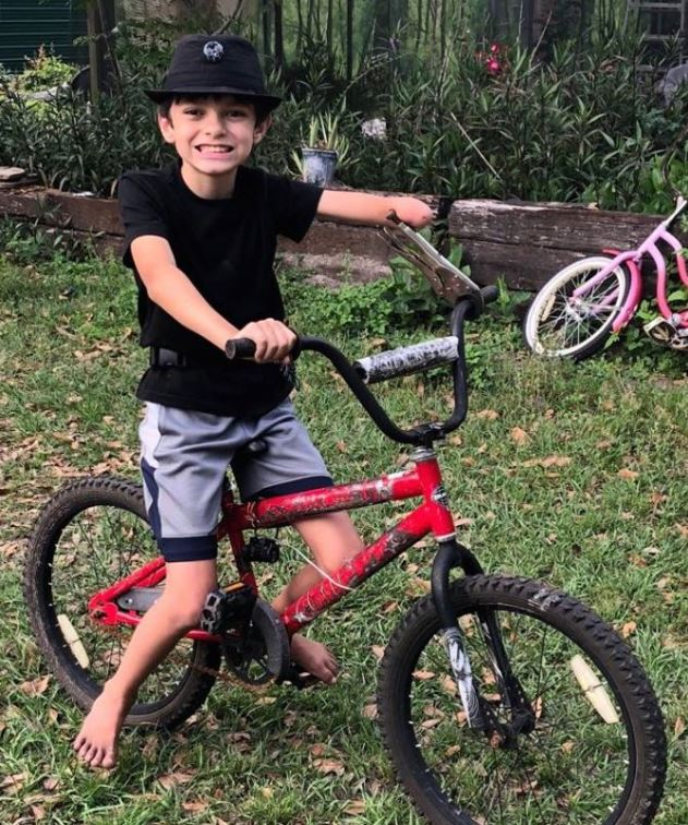 Aidan with his makeshift bike handlebar so he can ride - what a resourceful kid.